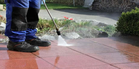 Pressure washing outdoor patio