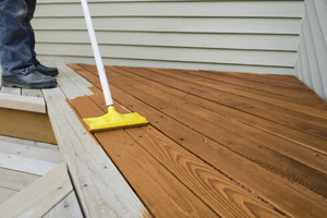Wooden deck being stained